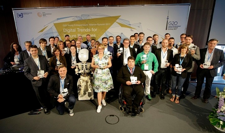 A WE DO DIGITAL Group picture of all 36 winners on stage at the G2ß Young Entrepreneur Summit.